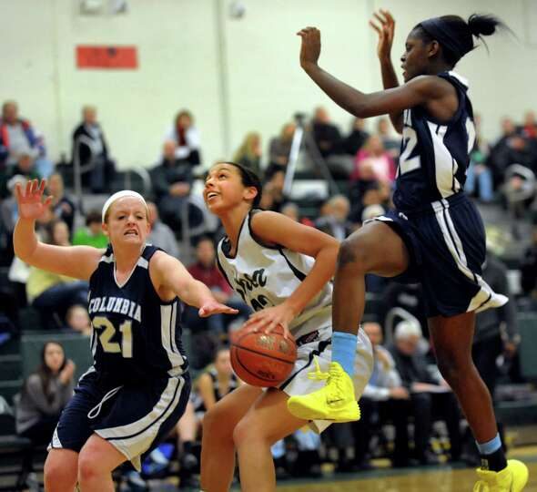 Shenendehowa's Sydney Brown, center, looks to shoot as Columbia's Casey Brown, left, and Natasja Joh