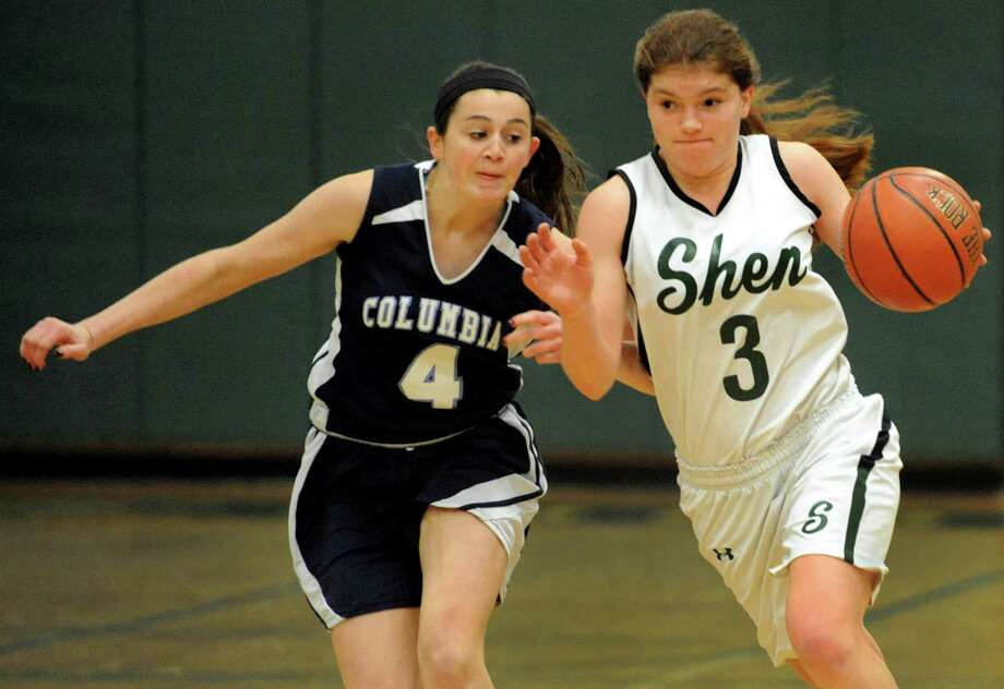 Shenendehowa's Madi Shea, right, drives up court as Columbia's Lindsey Mulligan defends during their basketball game on Saturday, Jan. 4, 2014, at Shenendehowa High in Clifton Park, N.Y. (Cindy Schultz / Times Union) Photo: Cindy Schultz / 00025247A