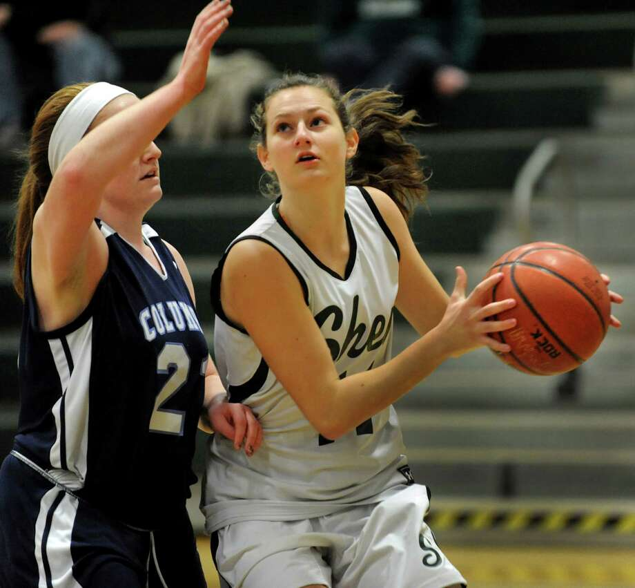Shenendehowa's Morgan O'Brien, right, looks to shoot as Columbia's Casey Brown defends during their basketball game on Saturday, Jan. 4, 2014, at Shenendehowa High in Clifton Park, N.Y. (Cindy Schultz / Times Union) Photo: Cindy Schultz / 00025247A