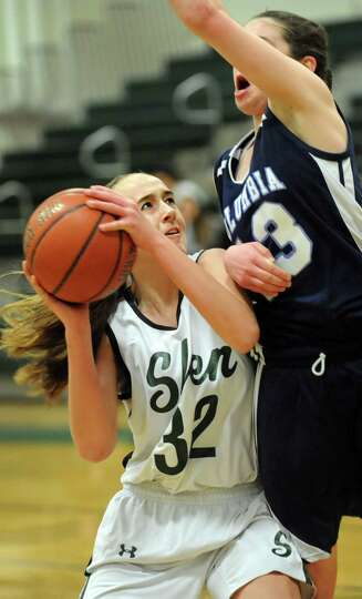 Shenendehowa's Carly Boland, left, looks to shoot as Columbia's Sarah Jaromin defends during their b