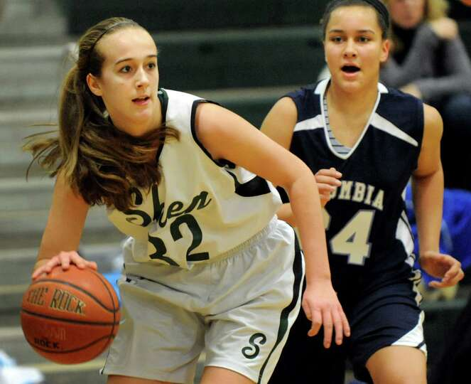 Shenendehowa's Carly Boland, left, controls the ball as Columbia's Selena Lott defends during their