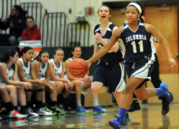 Columbia's Nia Moore, right, drives up court during their basketball game against Shenendehowa on Sa