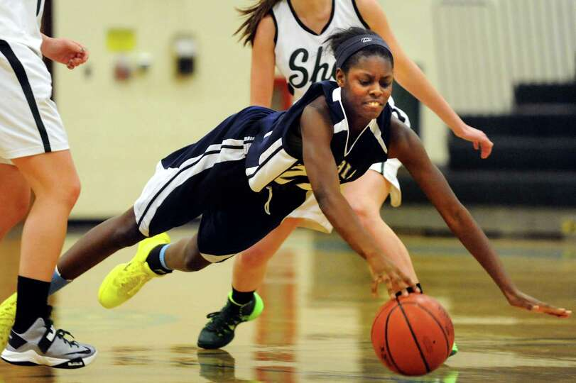 Columbia's Natasja Johnston, center, dives for the ball during their basketball game against Shenend