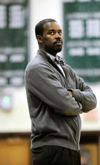 Columbia's coach Jabari Holder keeps an eye on the scoreboard during their basketball game against S