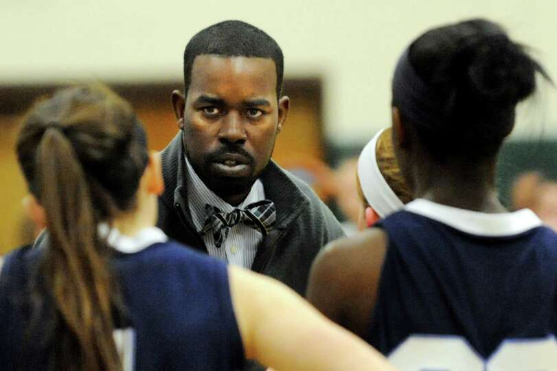 Columbia's coach Jabari Holder meets with his players during their basketball game against Shenendeh