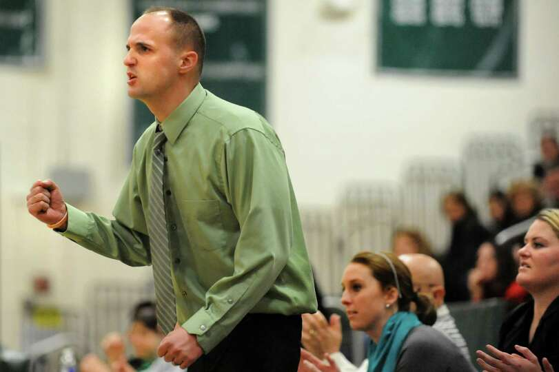 Shenendehowa's coach Joseph Murphy instructs his team during their basketball game against Columbia