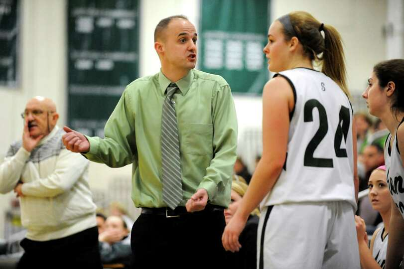 Shenendehowa's coach Joseph Murphy, center, talks with Ashley Acker on the sidelines during their ba