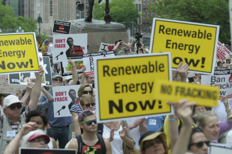 Protestors wave their signs as they listen to speakers during a rally by Opponents of the natural gas drilling method known as fracking on Monday, June 17, 2013, outside the Capitol in Albany, N.Y. The protestors were calling on Governor Andrew Cuomo to ban hydraulic fracturing in New York State. (Paul Buckowski / Times Union archive)