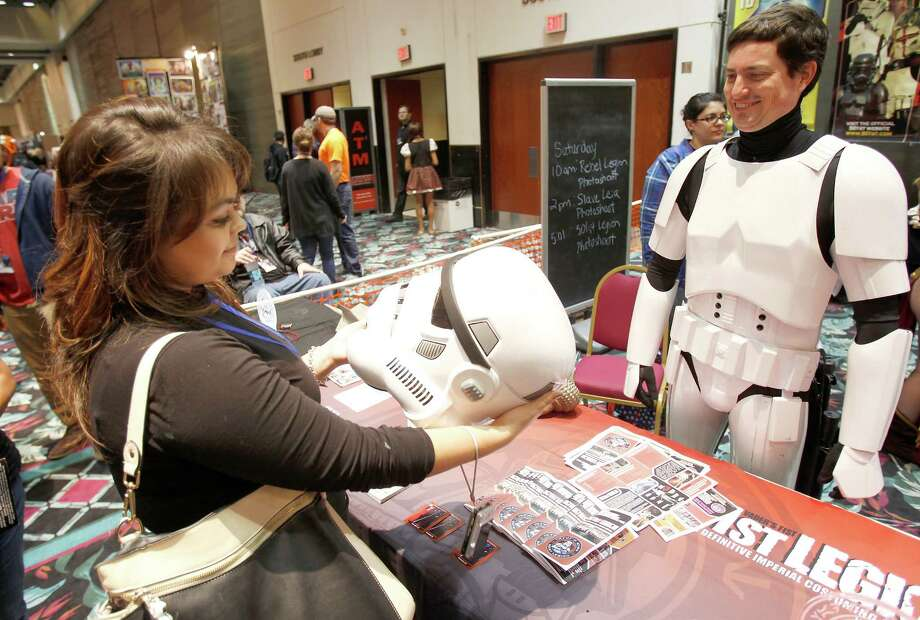 Miranda Hales, from Katy, looks at a Stormtrooper hat that was displayed by Travis Fitzgerald at Space City Con held at  Moody Gardens Hotel, Spa and Convention Center, in Galveston, Texas. Photo: Thomas B. Shea, The Houston Chronicle / © 2014 Thomas B. Shea