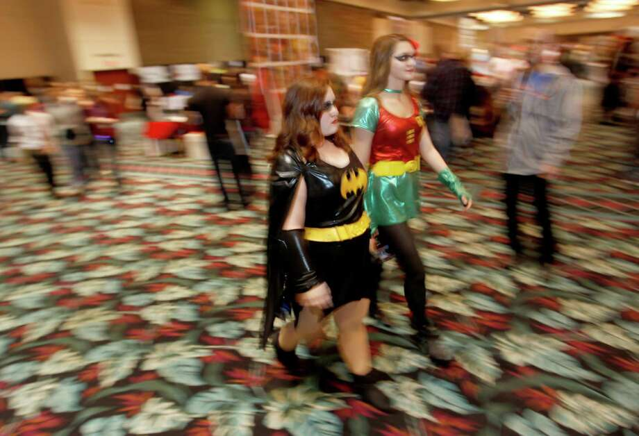 Katarina McCloskey, Bat Girl, from Humble and Sarah Smith, Robin Girl form Humble walk around the show room at Space City Con held at  Moody Gardens Hotel, Spa and Convention Center, in Galveston, Texas. Photo: Thomas B. Shea, The Houston Chronicle / © 2014 Thomas B. Shea