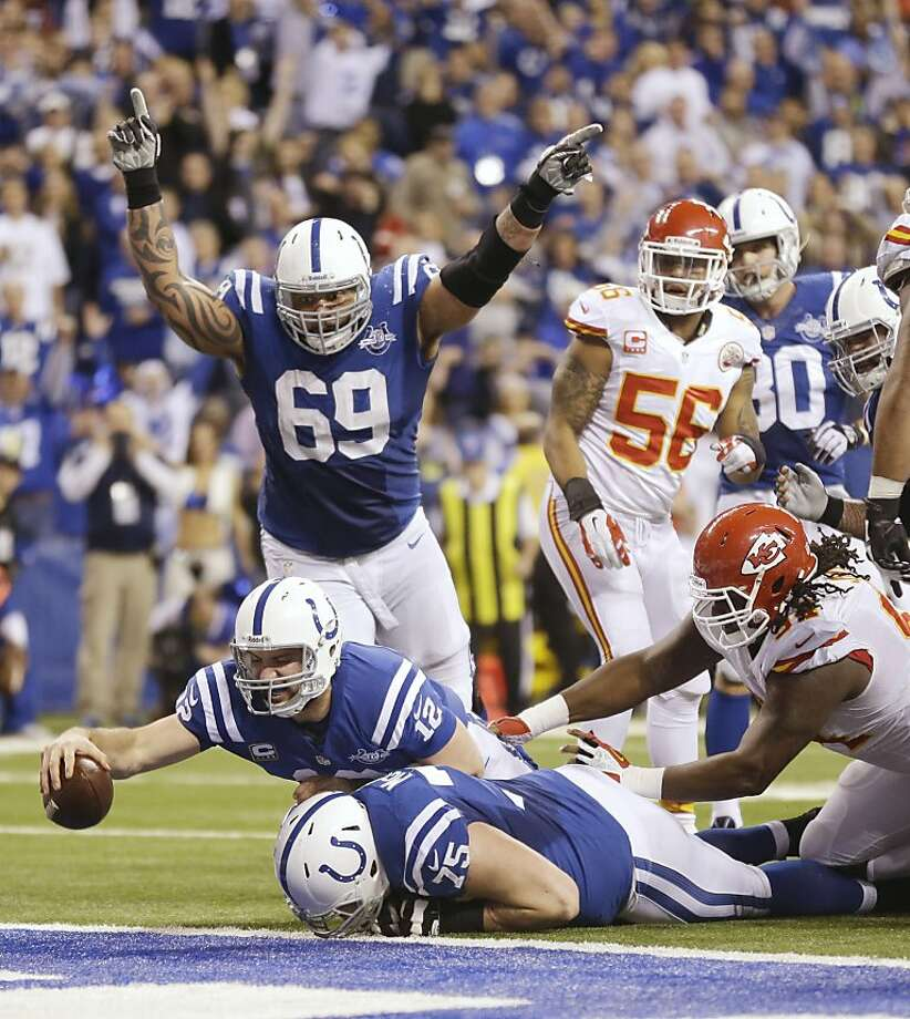 Andrew Luck scores a fourth-quarter touchdown after recovering a fumble in the backfield to cut the Chiefs' lead to 41-38. Minutes later, he threw the game-winning touchdown pass. Photo: Michael Conroy, Associated Press