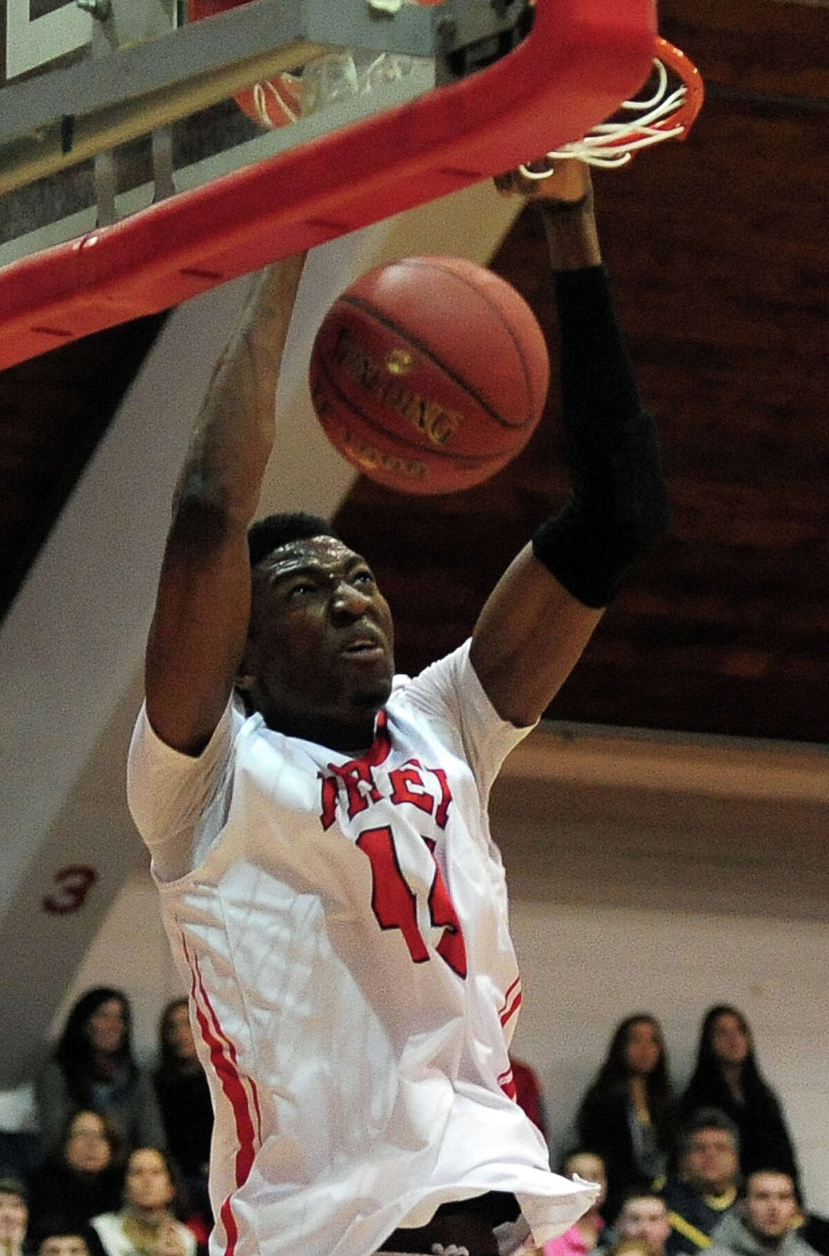 Fairfield Prep's Paschal Chukwu slam dunks the ball, during boys basketball action against Hillhouse in Fairfield, Conn. on Saturday January 4, 2014.