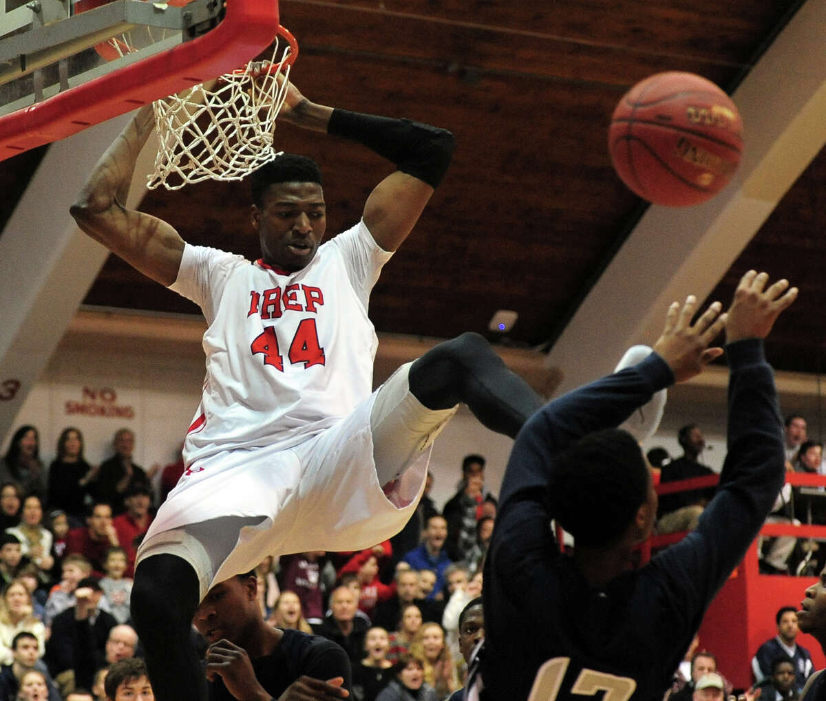 Fairfield Prep's Paschal Chukwu follows through on a slam dunks, during boys basketball action against Hillhouse in Fairfield, Conn. on Saturday January 4, 2014.