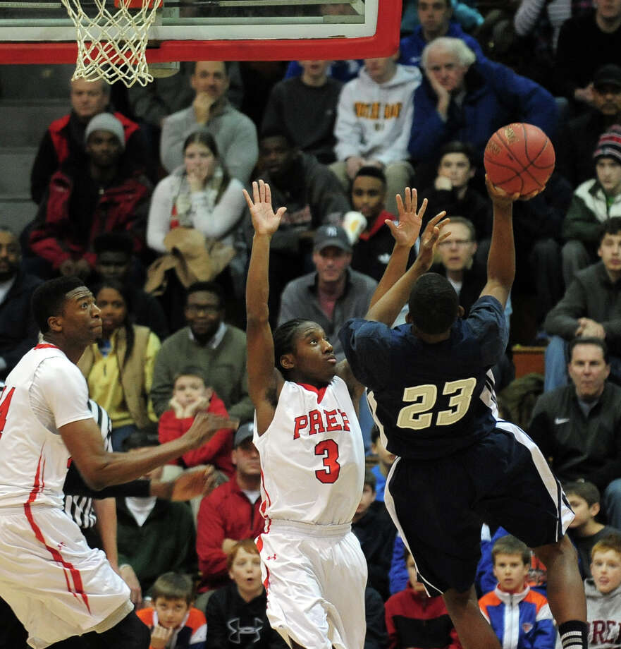 Fairfield Prep's Keith Pettway tries to block a shot attempt by Hillhouses's Raiquan Clark, during boys basketball action in Fairfield, Conn. on Saturday January 4, 2014. Photo: Christian Abraham / Connecticut Post