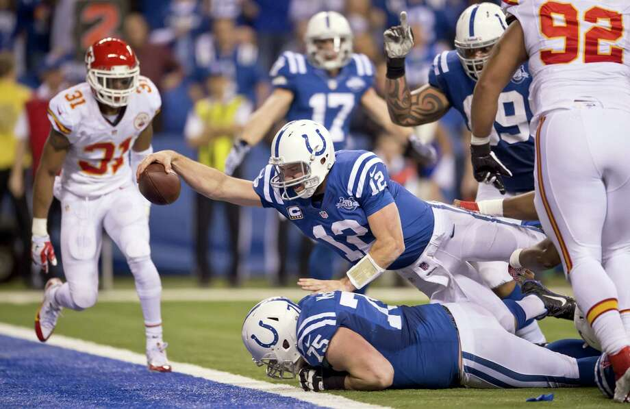Colts quarterback Andrew Luck dives over the goal line for a fourth-quarter touchdown in Indianapolis' win Saturday at Lucas Oil Stadium. The Colts came back from a 28-point deficit, the second-largest margin erased in an NFL playoff game. Photo: David Eulitt, MBR / Kansas City Star
