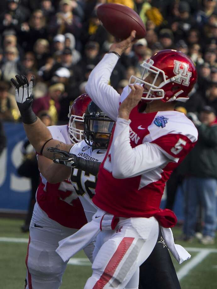 Jan. 4 Vanderbilt 41, UH 24Record: 8-5UH quarterback John O'Korn attempts a throw against Vanderbilt. Photo: Cody Duty, Houston Chronicle
