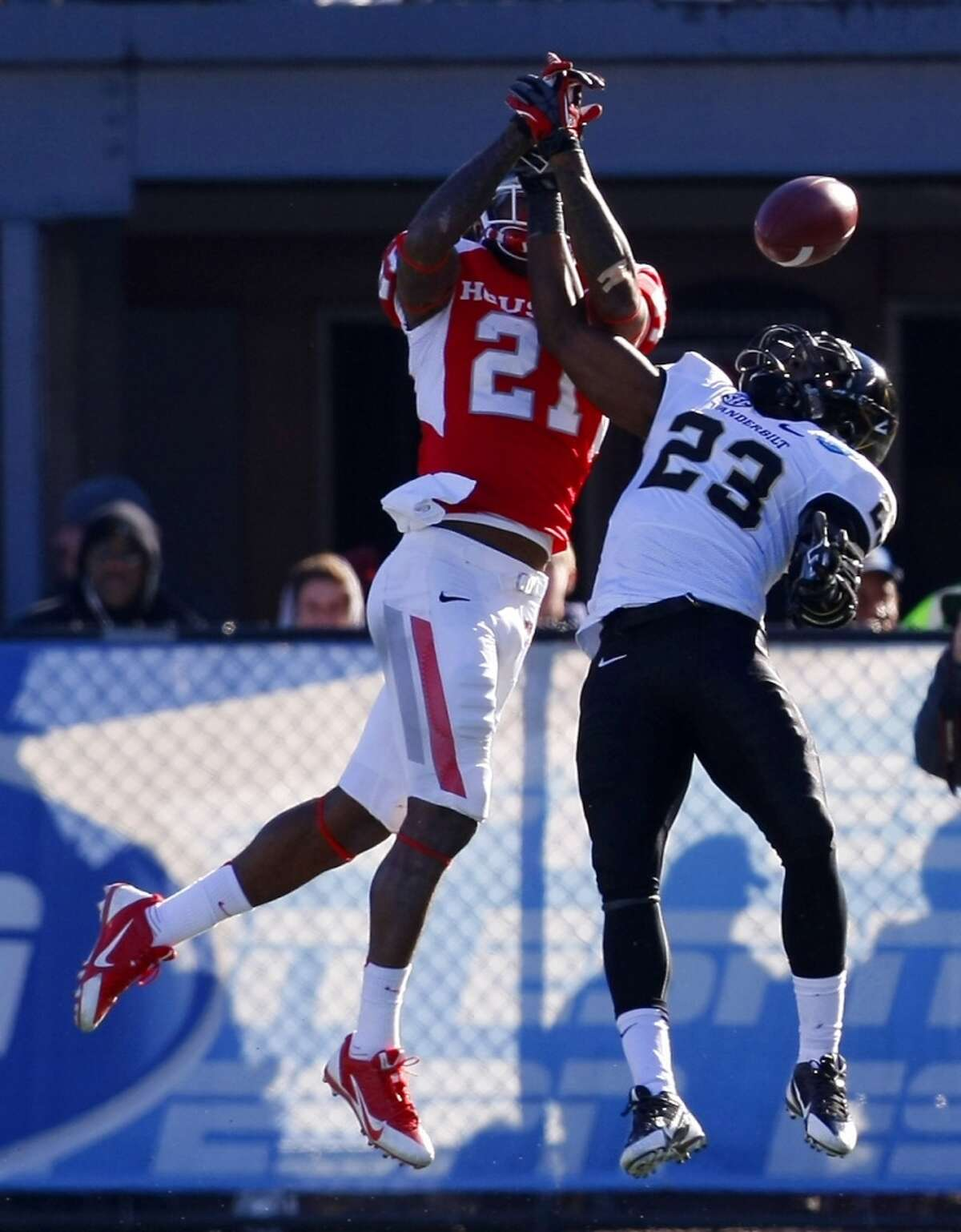 A pass intended for UH receiver Markeith Ambles is deflected by a Vanderbilt defender.