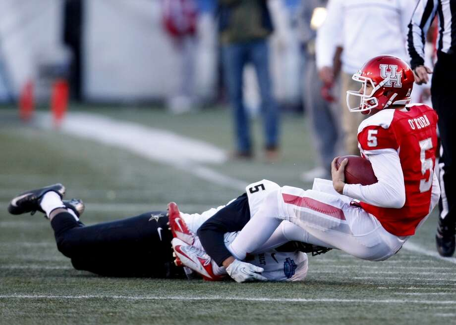 UH quarterback John O'Korn is sacked against Vanderbilt. Photo: Cody Duty, Houston Chronicle