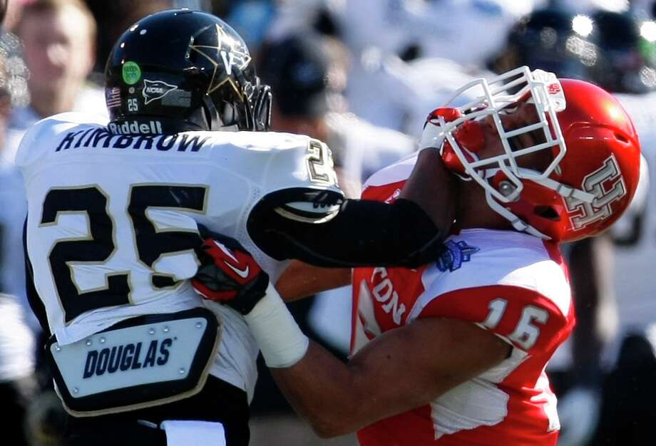 Vanderbilt running back Brian Kimbrow stiff arms Adrian McDonald of the Cougars. Photo: Cody Duty, Houston Chronicle / © 2013 Houston Chronicle