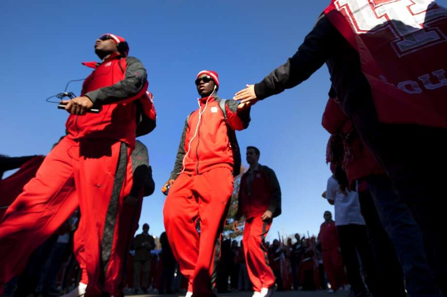 UH players arrive to the stadium to play Vanderbilt in the BBVA Compass Bowl. Photo: Cody Duty, Houston Chronicle