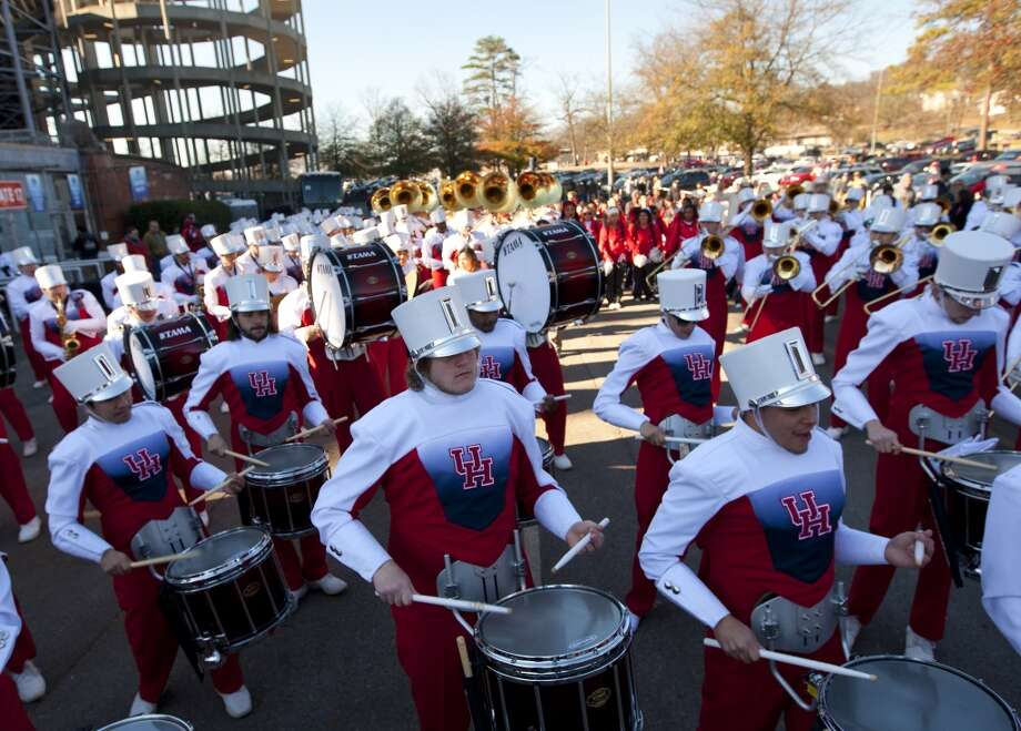 UH players are greeted by the school band before the BBVA Compass Bowl against Vanderbilt. Photo: Cody Duty, Houston Chronicle