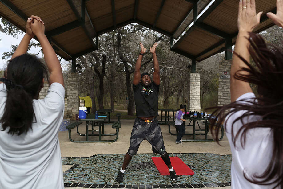 Michael Jones, an Army veteran, leads a high-intensity interval training class with Fitness in the Park at McAllister Park. Although called boot camps, he says his sessions don't feature any in-your-face yelling. Photo: Photos By Lisa Krantz / San Antonio Express-News / San Antonio Express-News