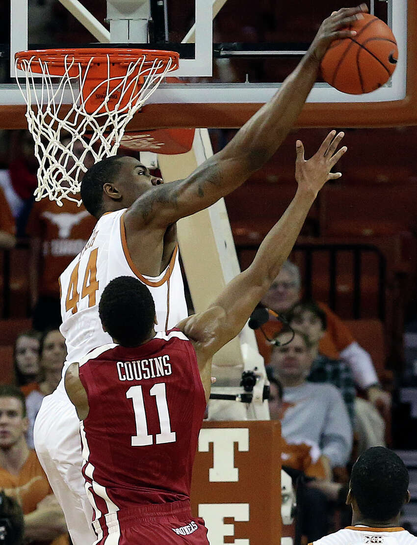 Texas center Prince Ibeh swats a shot away from Isiah Cousins as the Longhorns play Oklahoma in the Erwin Center on January 4, 2014.