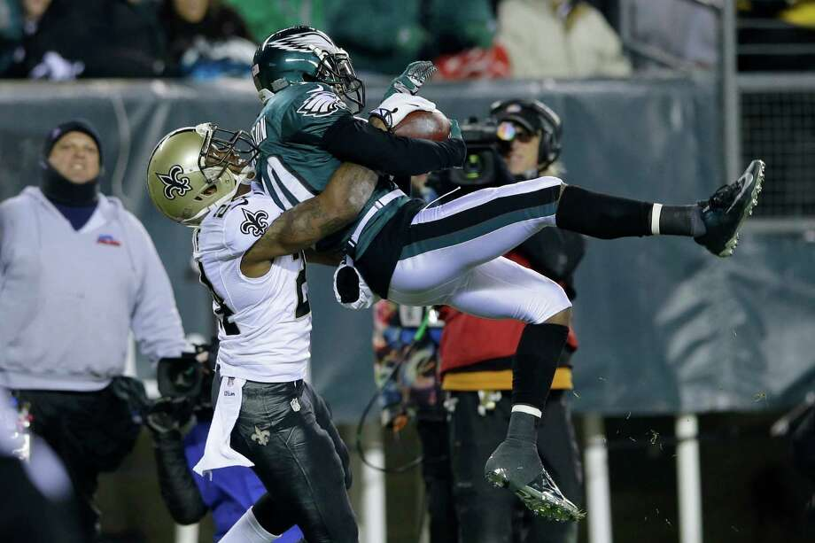 The Eagles' DeSean Jackson pulls in a pass against the Saints' Corey White in the second half. Photo: Michael Perez, FRE / FR168006 AP