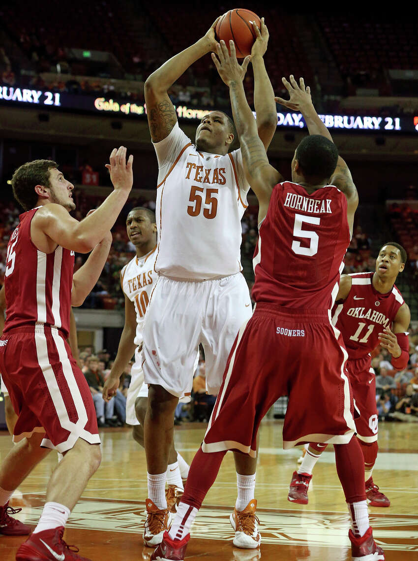 Texas center Cameron Ridley takes a jumper in the lane in the first half as the Longhorns play Oklahoma in the Erwin Center on January 4, 2014.