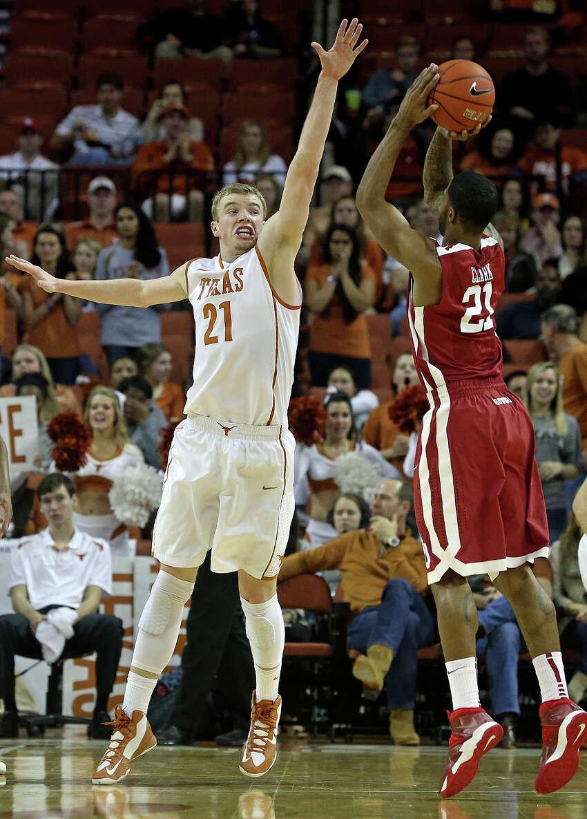 Texas forward Connor Lammert defends against Cameron Clark as the Longhorns play Oklahoma in the Erwin Center on January 4, 2014.