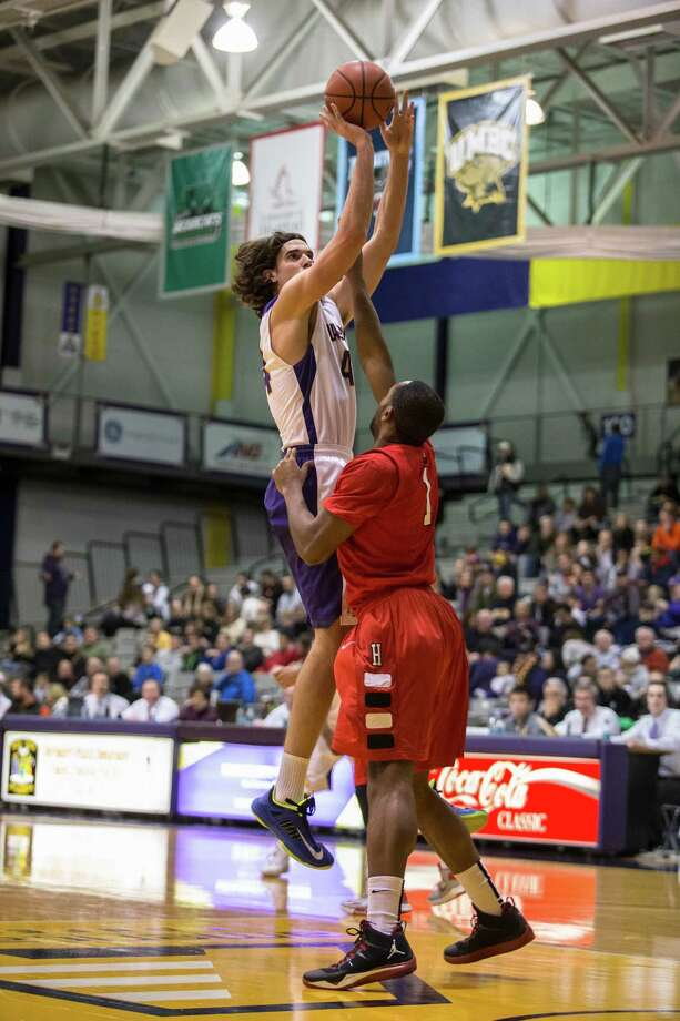 UAlbany's John Puk #44 puts up a jumper over Hartford's Mark Nwakamma #1 during UAlbany's America East opening game, Saturday at SEFCU Arena, Jan. 04, 2013 in Albany, N.Y. (Dan Little/Special to the Times Union) Photo: Dan Little / Copyright Dan Little