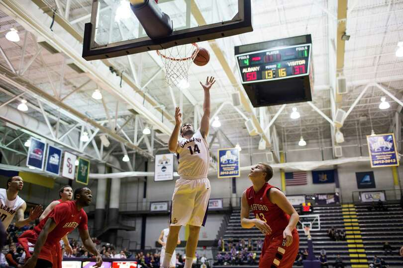 UAlbany's Sam Rowley #14 goes in for a layup during UAlbany's America East opening game against Hart