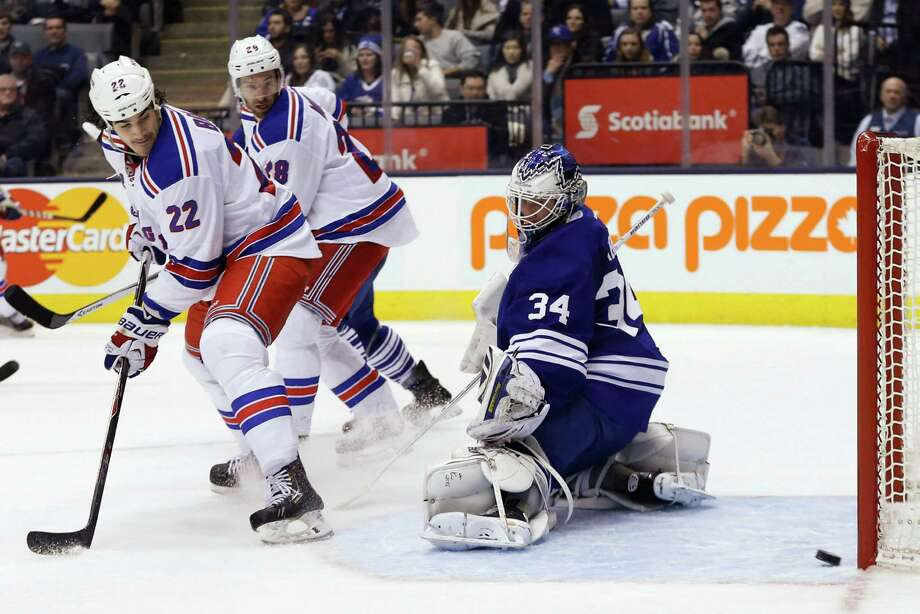 New York Rangers' Brian Boyle, left, scores a goal past Toronto Maple Leafs goalie James Reimer during the third period of an NHL hockey game in Toronto, Saturday, Jan. 4, 2014. (AP Photo/The Canadian Press, Mark Blinch) ORG XMIT: MDB118 Photo: Mark Blinch / The Canadian Press