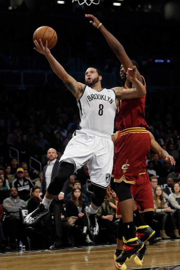 Brooklyn Nets' Deron Williams (8) drives past Cleveland Cavaliers' Tristan Thompson (13) during the first half of an NBA basketball game on Saturday, Jan. 4, 2014, in New York. (AP Photo/Frank Franklin II) ORG XMIT: NYFF108 Photo: Frank Franklin II / AP