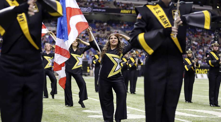 Alexandra Arranaga, a Churchill High School student, performs with the U.S. Army All-American Bowl marching band color guard during halftime. Two other North East ISD students also were part of the marching band. Photo: Edward A. Ornelas / San Antonio Express-News / © 2014 San Antonio Express-News