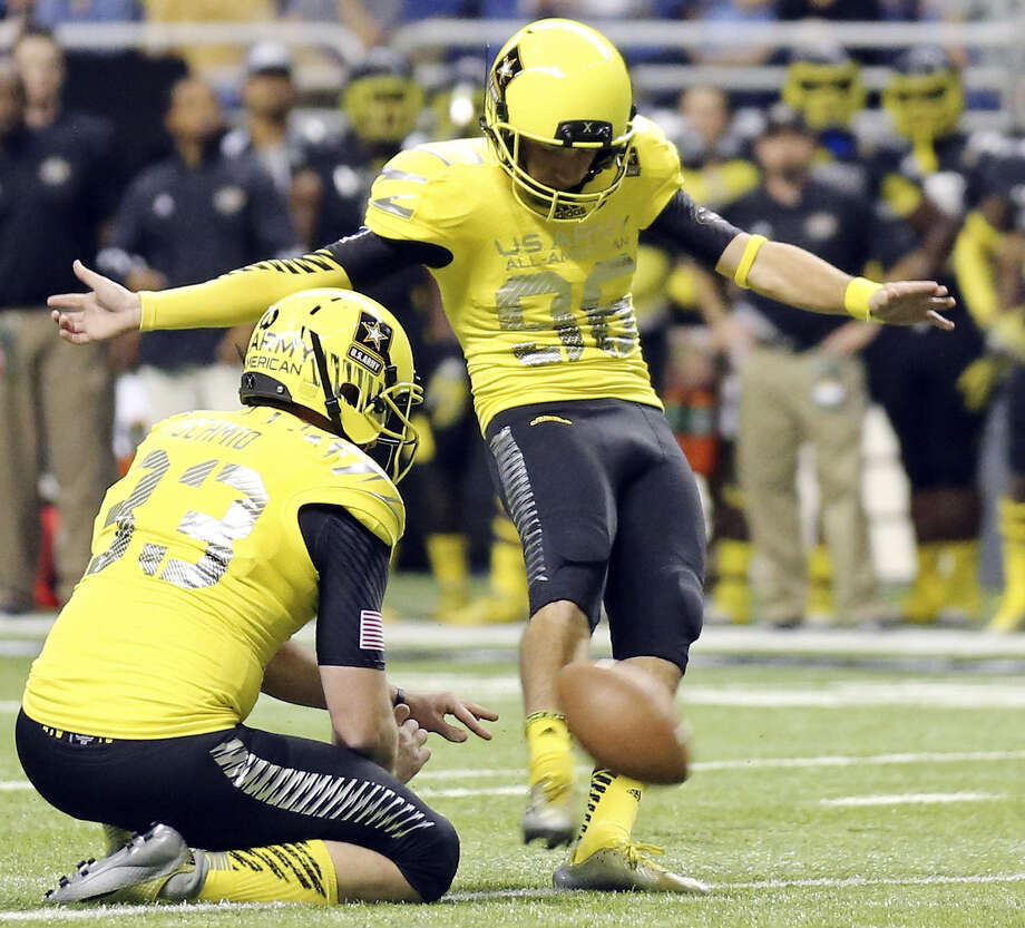 The West's Clayton Hatfield, of Boerne Champion High, kicks one of his four extra points as Zach Schmid holds during their 28-6 U.S. Army All-American Bowl victory at the Alamodome. Photo: Edward A. Ornelas / San Antonio Express-News / © 2014 San Antonio Express-News
