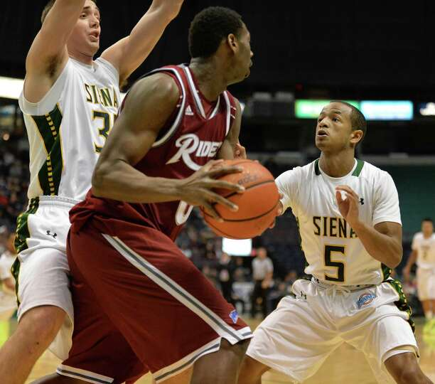 Siena's #31 Brett Bisping, left, and #5 Evan Hymes, at right, double team Rider's #0 Kahlil Thomas d