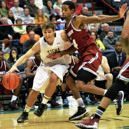 Siena's #31 Brett Bisping, left, drives by Rider's #14 Shawn Valentine during Saturday's game at the