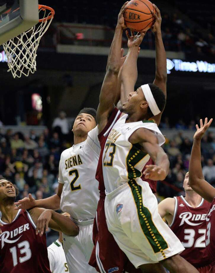 Siena's #2 Javion Ogunyemi, left, and #23 Maurice White try to outrebound Rider during Saturday's game at the Times Union Center Jan. 04, 2014, in Albany, NY.  (John Carl D'Annibale / Times Union) Photo: John Carl D'Annibale / 00025111C