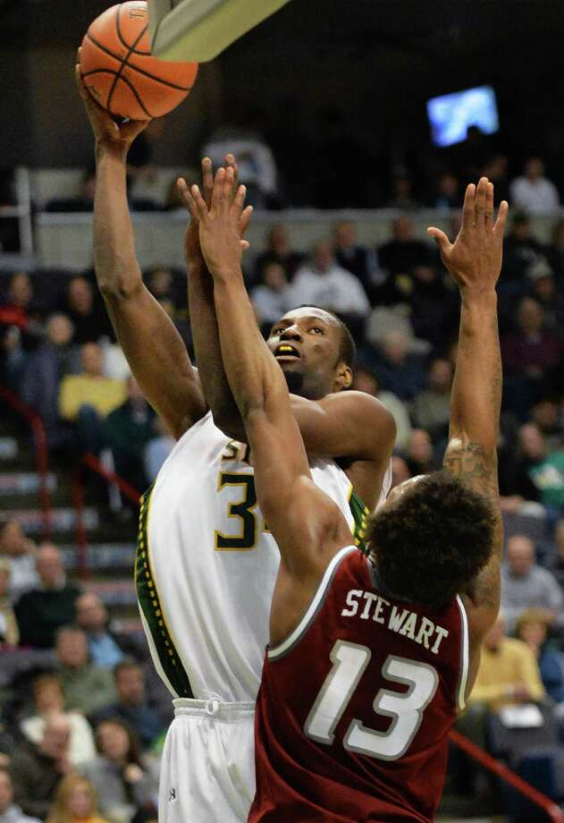 Siena's #34 Imaoh Silas, left, and Rider's #13 Daniel Stewart during Saturday's game at the Times Union Center Jan. 04, 2014, in Albany, NY.  (John Carl D'Annibale / Times Union) Photo: John Carl D'Annibale / 00025111C