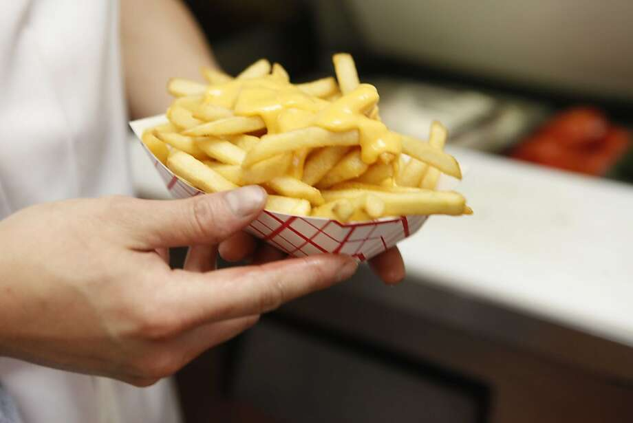 Regularly consuming potatoes in any form, including french fries, can cause weight gain. Photo: Mike Kepka, The Chronicle