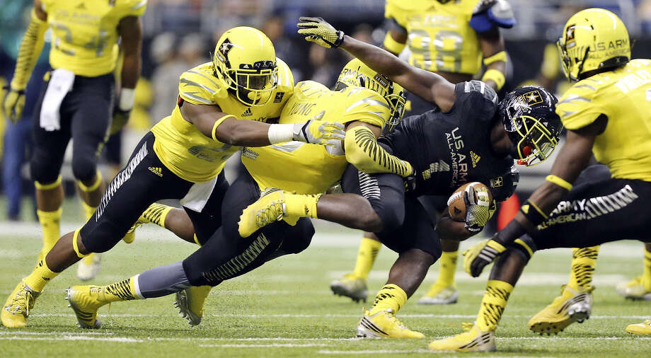 West defenders, including Kenny Young (center), tackle the East's Sony Michel at the U.S. Army All-American Bowl. Photo: Edward A. Ornelas / San Antonio Express-News / © 2014 San Antonio Express-News