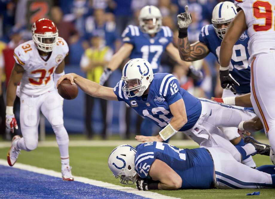 Indianapolis Colts quarterback Andrew Luck (12) dives over the goal line after recovering a teammate's fumble, for a touchdown in the fourth quarter against the Kansas City Chiefs during an AFC Wild Card Game at Lucas Oil Stadium in Indianapolis, Ind., Saturday, Jan. 4, 2014. The Colts beat the Chiefs, 45-44. (David Eulitt/Kansas City Star/MCT) Photo: David Eulitt, McClatchy-Tribune News Service / Kansas City Star