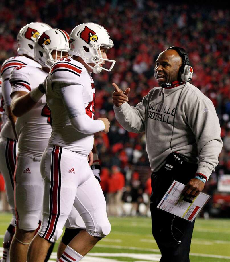 Charlie Strong, right, worked wonders at Louisville, winning 23 games over the past two seasons. Photo: Mel Evans, STF / AP