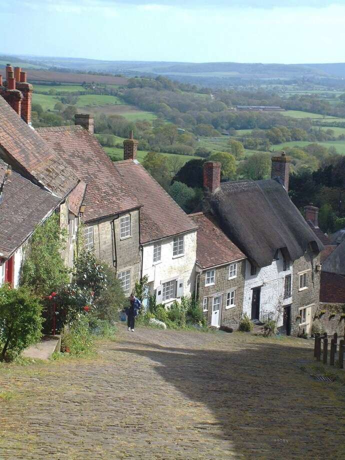 "The steep, cobblestoned streets and cottages on Gold Hill in Shaftesbury, Dorset -- called ""Shaston"" in Thomas Hardy's novels -- might see increased tourism in 2014 after the debut of a new film adaptation of ""Far From the Madding Crowd."" Photo: Courtesy VisitEngland.com"