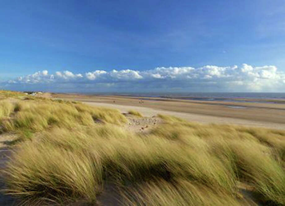 "Camber Sands, the only dune complex in East Sussex, will appear in two major movies coming out in February 2014: ""Monuments Men,"" a World War II epic  starring George Clooney, Matt Damon and Cate Blanchett, and ""The Invisible Woman,"" a film about Charles Dickens and his secret paramour, starring Ralph Fiennes and Kristen Scott Thomas. Photo: Visit 1066 Country"