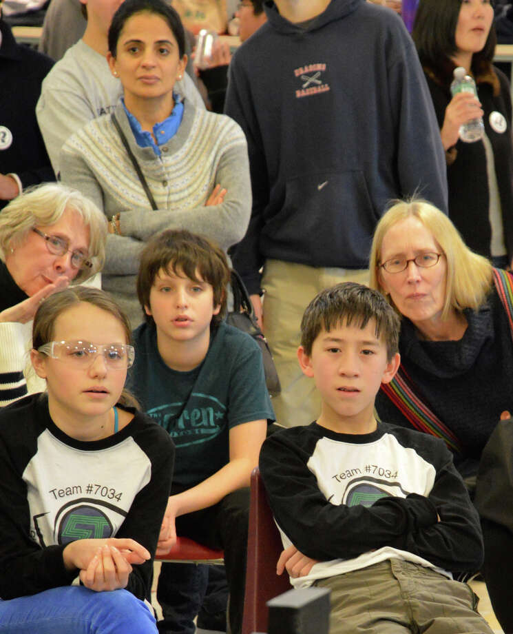 Fans closely follow the robotics competiton Saturday at Staples High School. Photo: Jarret Liotta / Westport News contributed
