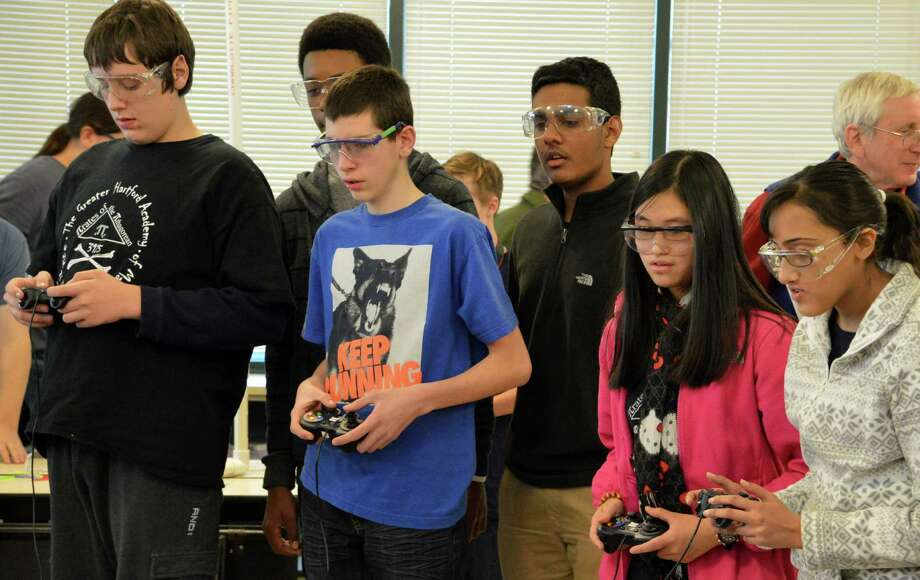 Saturday's robotics competition at Staples High School required teamwork between two alliance teams, who competed in each round with two others. Photo: Jarret Liotta / Westport News contributed