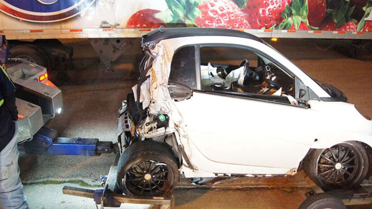 The driver of a Smart Car is in critical condition today after the driver of an 18-wheeler failed to see her, changed lanes and crushed the ultra-compact into a concrete barrier on U.S. 59 in the Porter area.