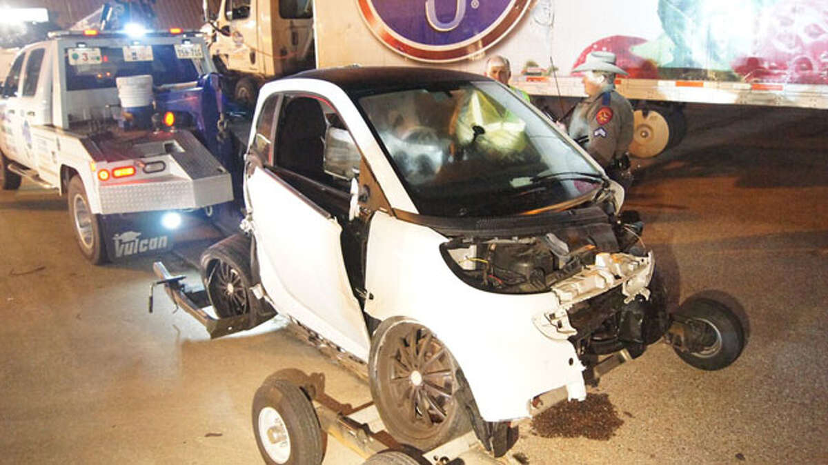 Porter Fire Department officials said they found the woman lying on the southbound lanes of the freeway, apparently ejected from the rear of the Smart Car. She was in critical condition at Memorial Hermann Hospital in Houston.